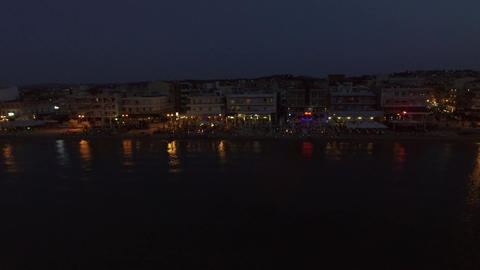 Flying over resort on the coast at night ビデオ