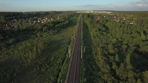 Aerial shot of railway running through the village, Russia Live Action