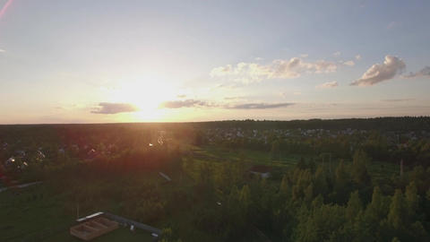 Aerial scene of village with railway at sunset, Russia Footage