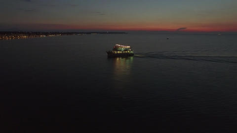 Aerial view of sailing touristic ship at night Filmmaterial