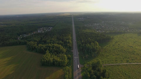 Car traffic on the countryside road in Russia, aerial Footage