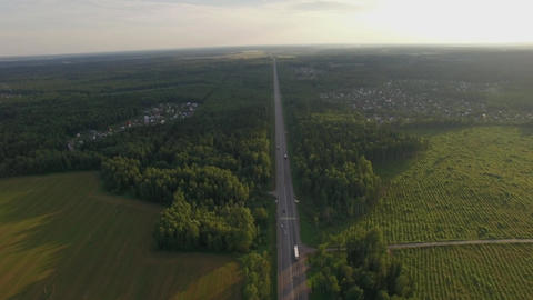 Car traffic on the countryside road in Russia, aerial Live Action