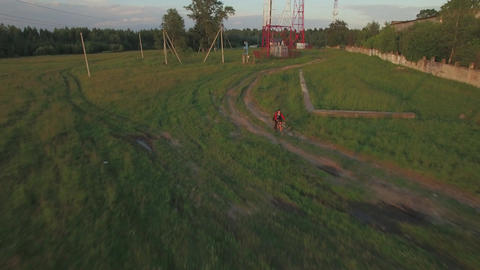 Teenager riding bike in the country, aerial view Image
