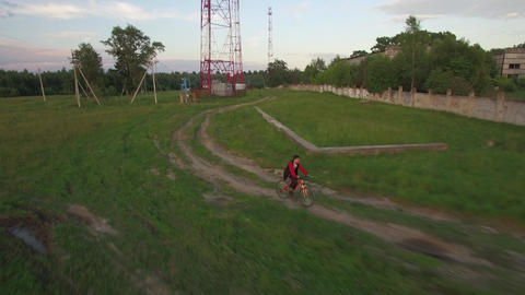 Aerial view of boy riding bike in the countryside Footage