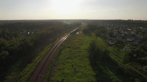 Flying over train in the countryside, Russia Footage