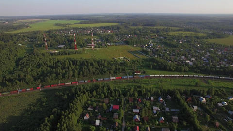 Summer houses in the countryside and freight train, aerial view Live Action