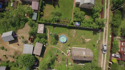 Flying over children in the pool and countryside houses, Russia Live Action