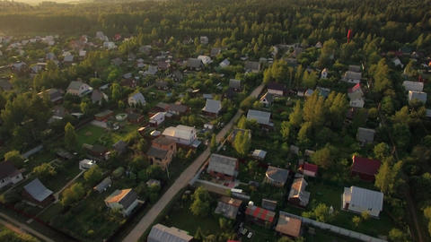 Flying over summer houses in green woods, Russia Live Action