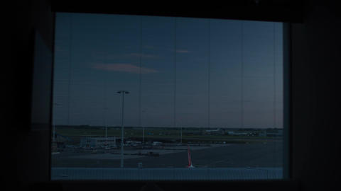 Timelapse of night, morning and day in Amsterdam airport Filmmaterial