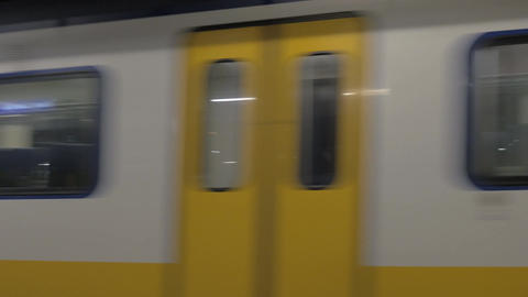 Arriving commuter train in Amsterdam Live Action