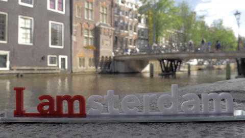 I amsterdam slogan and city view in background, Netherlands Footage