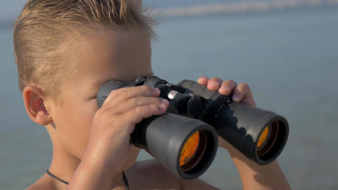 Little explorer with binoculars Footage