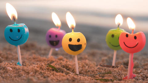 Smiley candles on the beach Footage