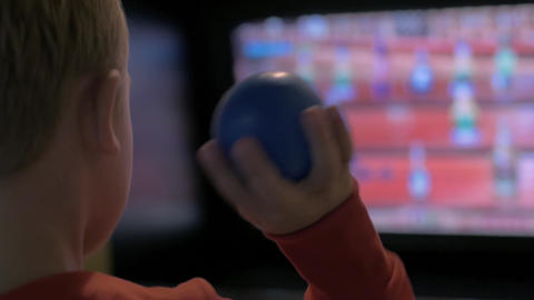 Child entertaining with arcade machine Footage