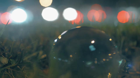 Traffic and glass orb at the roadside Footage