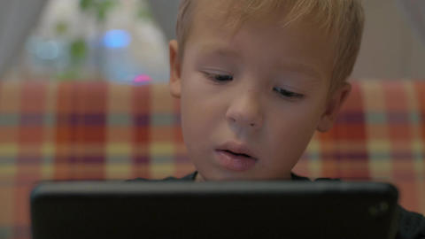Boy spending leisure time with tablet PC Footage