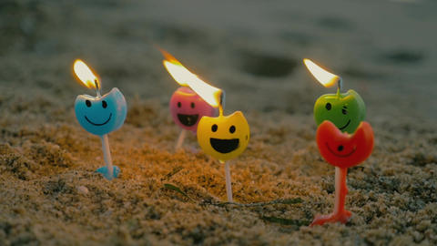 Burning candles with smiling faces Footage