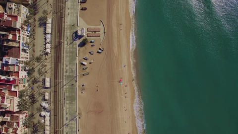 Aerial top view of beach, sea, railways and hotels, Barcelona, Spain Live Action