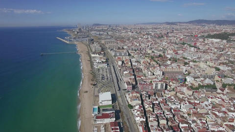 Aerial view of beach, sea, railways and hotels, Barcelona, Spain ビデオ