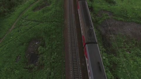 Aerial bird eye view of two railway different direction and moving trains, Russi 画像