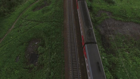 Aerial bird eye view of two railway different direction and moving trains, Russi Filmmaterial