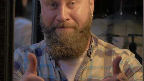 View of bearded bald man smiling and showing thumbs up Footage