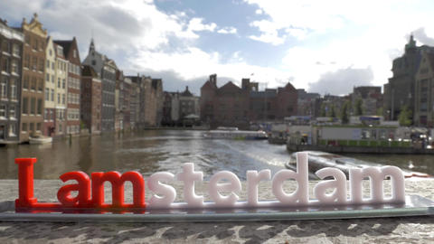 View of small plastic figure of Iamsterdam letters sculpture on the bridge again 画像