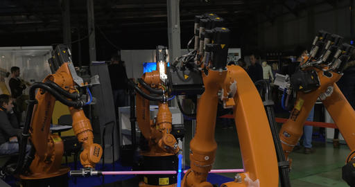 View of industrial robots that moving with light sticks Image