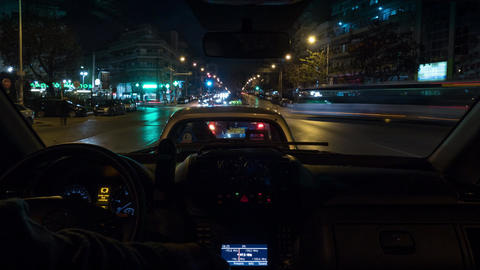 Timelapse of driving car in night city. Thessaloniki, Greece Footage
