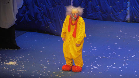 On snow show of Slava Polunin acts the clown in a yellow suit Footage