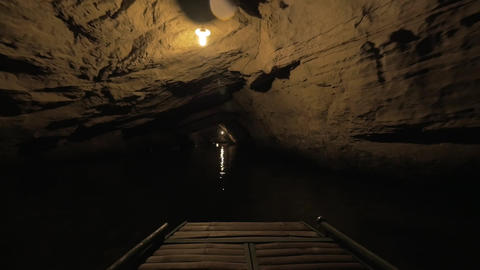 In Halong Bay in Hanoi, Vietnam seen river and dark grotto Footage