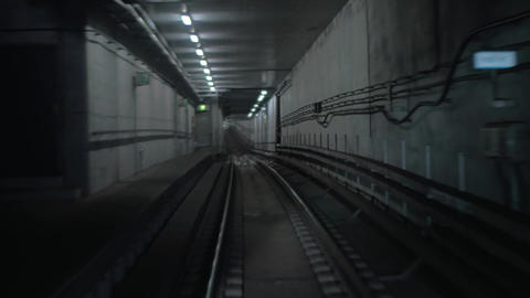 Subway train moving in tunnel and arriving to the station Footage