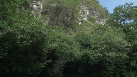 Boat sailing into karst cave. Trang An, Vietnam Footage