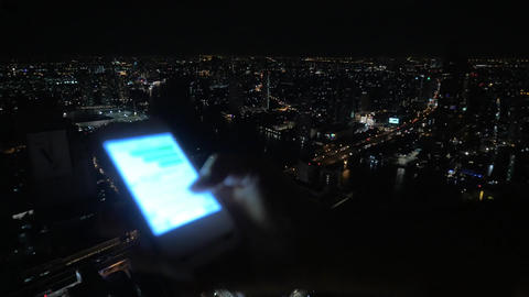 Girl typing message on cellphone on night city background Footage