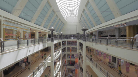 Seen a big multi-storey shopping centre with walking people Footage