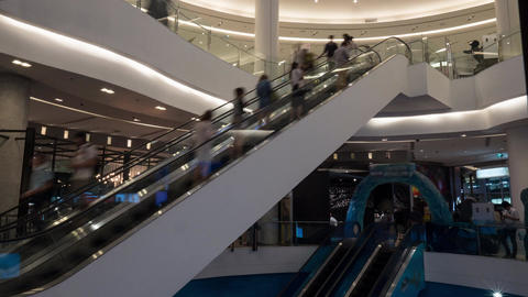Timelapse of people on escalators in trade centre Footage