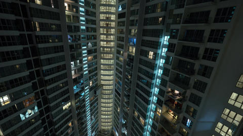 Timelapse of blinking windows in multistorey house Footage