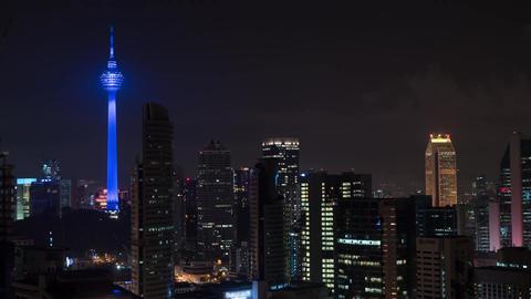 Timelapse of Kuala Lumpur. Night cityscape with Menara KL Tower Footage