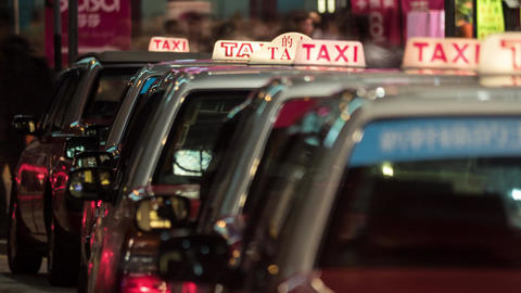 Timelapse of taxi cars waiting for clients in night Hong Kong ภาพวิดีโอ