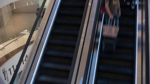 Timelapse of escalators with people in trade centre Footage
