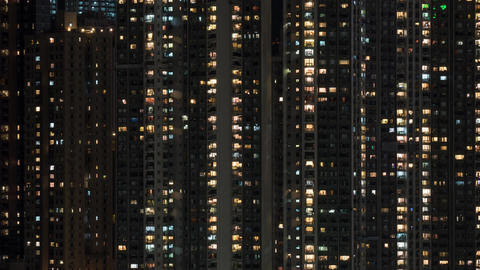 Timelapse of window lights in high-rise apartment block at night Live Action