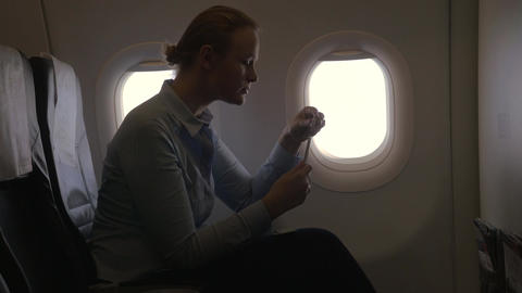 In airplane view of woman making payment with bank card... Stock Video Footage