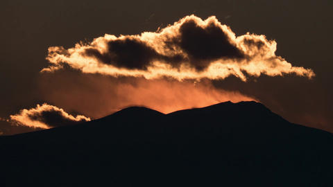 Timelapse of sunset and clouds over mountains Footage