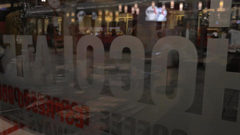 View through the glass window of coffee house, glass reflected cafe, Vienna, Aus Footage
