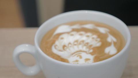 Close-up shot of barista finishing cream picture on latte matcha Footage