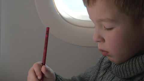 Close up view of small boy learning to writing with pencil Footage