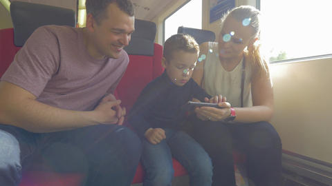 Family with child traveling by train and using cell Footage