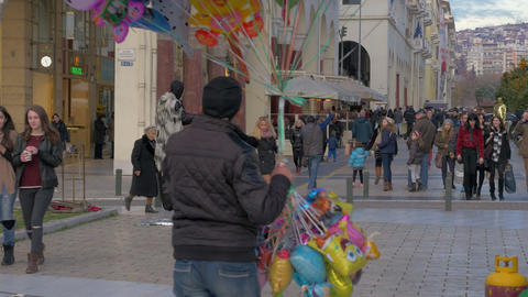 Around view of people are walking along the pedestrian street in the daytime. Th Footage