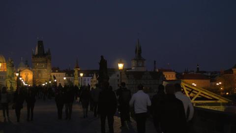 Night Prague and people on Charles Bridge Live Action