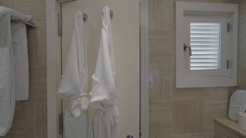 Closing bathroom door in the hotel Live Action